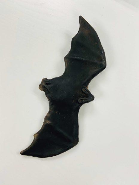 Ceramic bat sculpture by artist Celia Eberle
