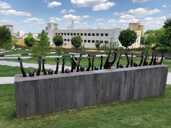 Raise Up, 2016. Bronze, approx. 25 feet long. View of work installed at the National Memorial for Peace and Justice, 2018. Photo: © Hank Willis Thomas