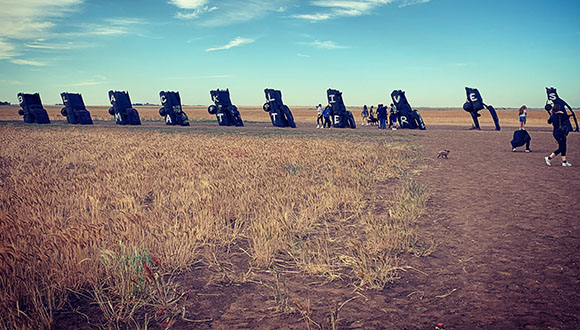 A-photograph-by-Ali-Reed-of-Amarillo's-Cadillac-Ranch-Trash-cans-painted-with-the-words-Black-Lives-Matter