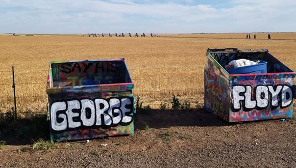 A-photograph-on-Reddit-of-Amarillo's-Cadillac-Ranch-Trash-cans-painted-with-the-words-George-Floyd