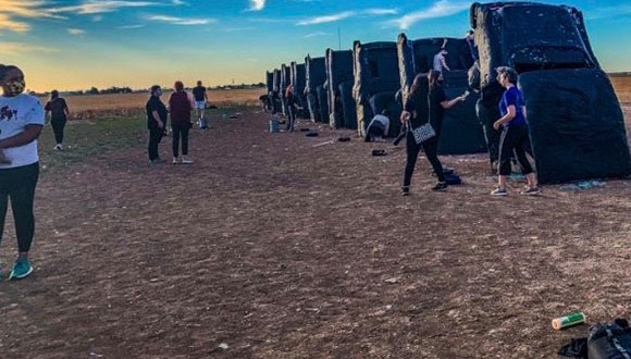 Detail-photograph-by-Ali-Reed-of-Amarillo's-Cadillac-Ranch-Trash-cans-painted-with-the-words-Black-Lives-Matter