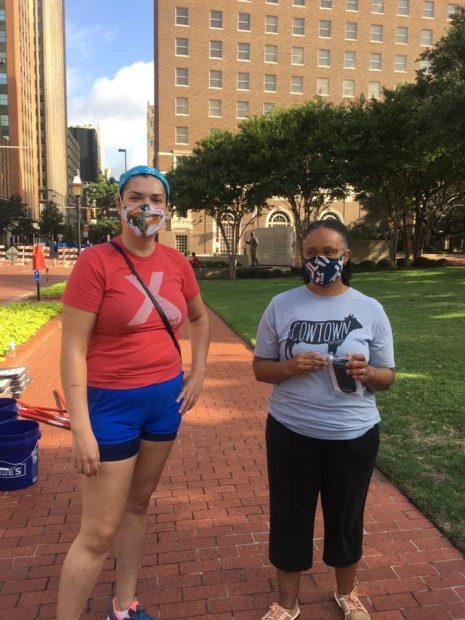 Letitia Huckaby-Right-and a volunteer