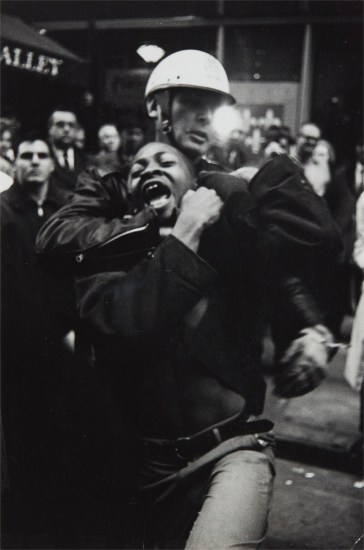 """The Arrest of Taylor Washington, Leb's Restaurant, Atlanta,1963-printed 1967."" by Danny Lyon"""