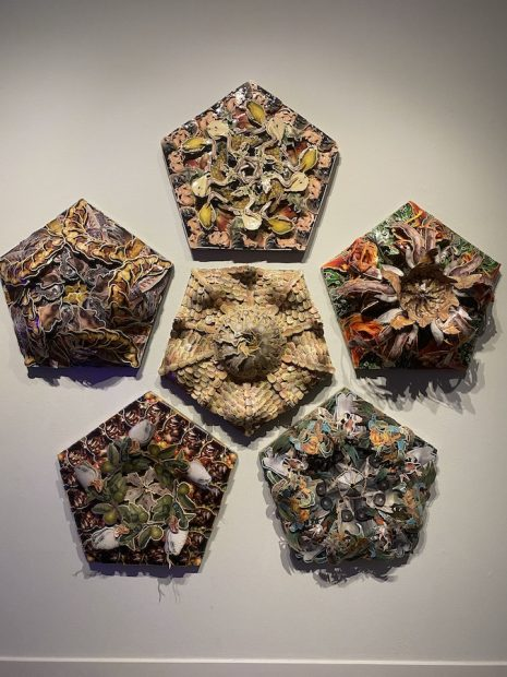 Wall with Turk's six pentagon-shaped sculptural collages.
