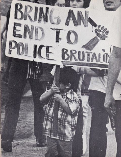 Child with sign at anti-police brutality demonstration in L.A., 1971