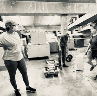Museum staff in the archives after hurricane Hanna. Via AMST Facebook page.