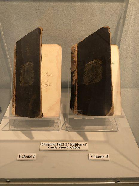"""Harriet Beecher Stowe's Uncle Tom's cabin (1st edition), which the display points out as stoking divisions making slavery """"one of the major issues that led to civil war"""