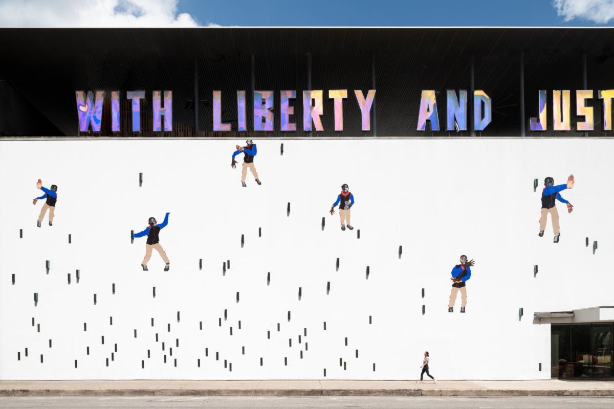 """Deborah Roberts' """"Little Man, little man,"""" a mural installation at the Contemporary Austin's Jones Center"""