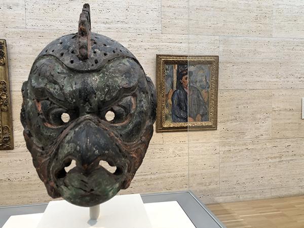 Gigaku Mask of the Karura Type, 8th century Japanese. Back; Man in a Blue Smock, c. 1896–97 Paul Cézanne.