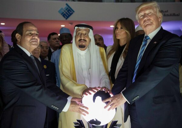Donald Trump touching a glowing orb