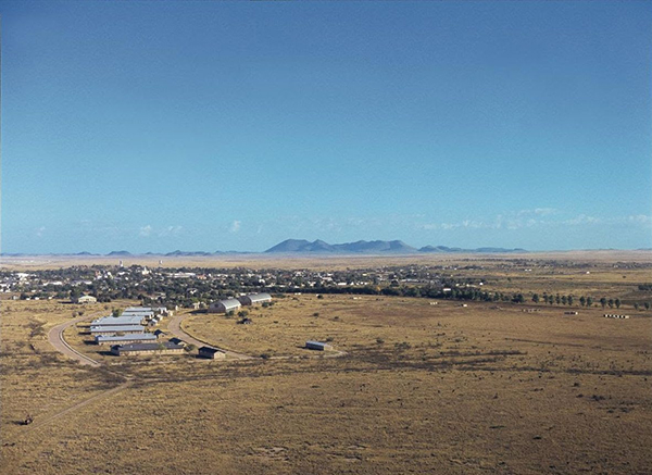 View of Marfa with the Puertacita Mountains in the background, the Chinati Foundation in the foreground. Photo by Florian Holzherr