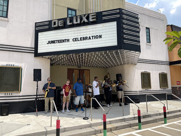 A band plays outside the DeLuxe Theater, 5th Ward, Houston Juneteenth 2021