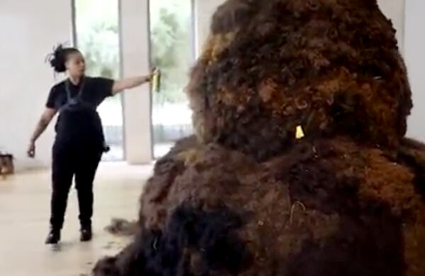 Jer'Liza Devezin spraying down her sculpture at the Nasher. Video still. Video Credit-Ciara Elle Bryant